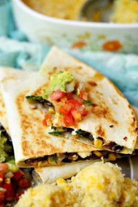 These Vegetarian Quesadillas are LOADED with goat cheese, cheddar, corn, black beans, and poblano peppers. They're quick and easy, and great for lunch or busy weeknight dinners!