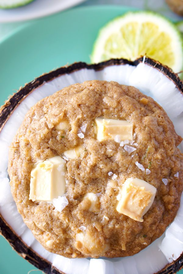 Top view of a Paradise Cookie with Macadamia Nuts sitting on half of a coconut