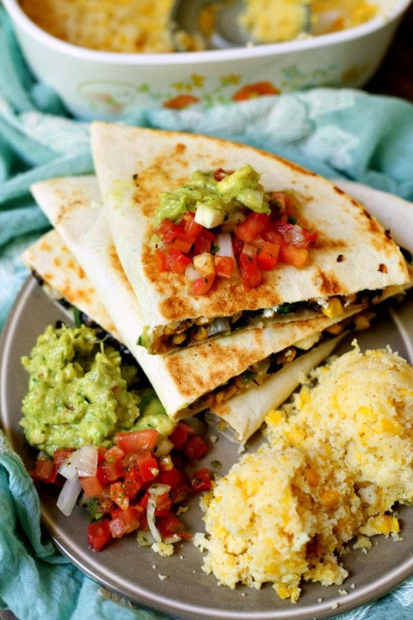 Easy Vegetarian Quesadillas on a plate with a side of guacamole and salsa