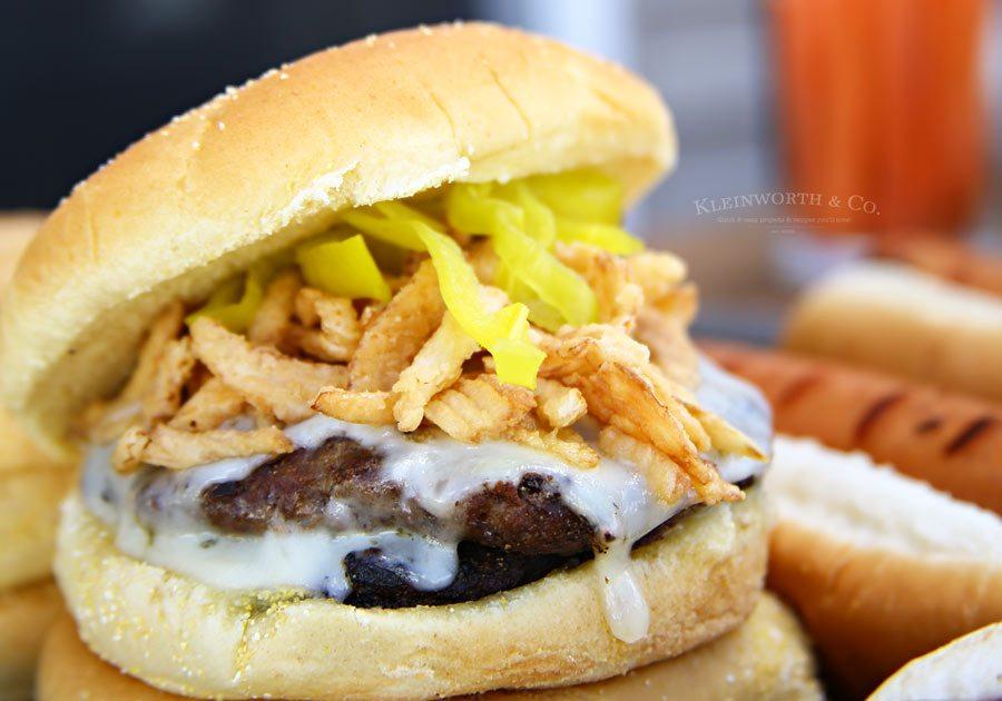 A close-up of a Havarti Onion Burger