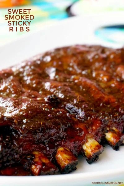 Smoked spareribs with text overlay for Pinterest.