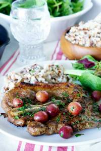 This Skillet Pork Chops with Grapes and Caramelized Shallots recipe is a delicious dinner for easy weeknight meals, and it's dressy enough for company.