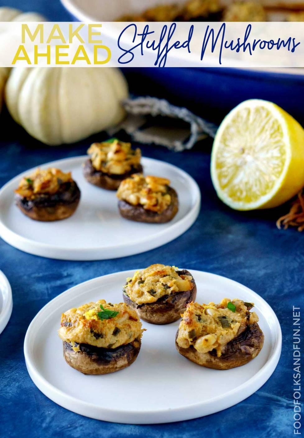 Stuffed mushrooms on white plates.