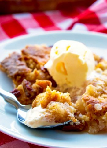 Apple Pie Dump Cake with a scoop of ice cream on a plate