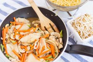 Stir in bean sprouts and noodles and toss to combine and evenly coat everything in sauce, about 1 minute. Transfer chicken chow mein to platter, sprinkle with scallion greens and serve.