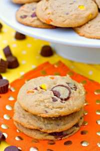 These Loaded Peanut Butter Cookies are big, chewy, and full of peanut butter goodness. They're loaded with Reese's Pieces and Reese's Mini Peanut Butter Cups.
