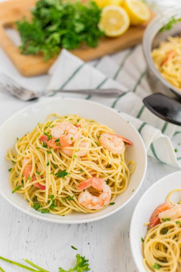 """The word """"scampi"""" refers to an Italian dish made with lobster or shrimp that's poached in white wine, garlic, and chicken stock and served with parmesan cheese. Scampi can refer to the cooking style or the lobster or shrimp themselves. Shrimp Scampi is the same as above but served over pasta, usually spaghetti or linguine."""