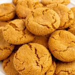 The finished gingersnap cookie recipe on a white serving plate.