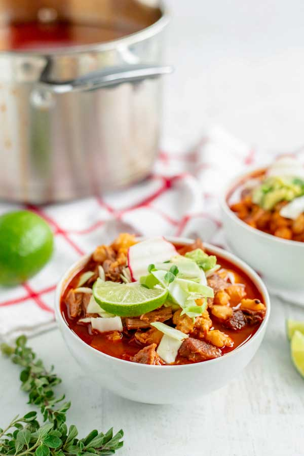 An individual serving in a bowl of New Mexico Posole