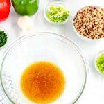 Whisk together the vinegar, oil, salt and pepper.