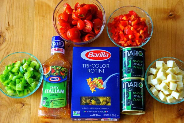 All of the ingredients that you need for pasta salad.