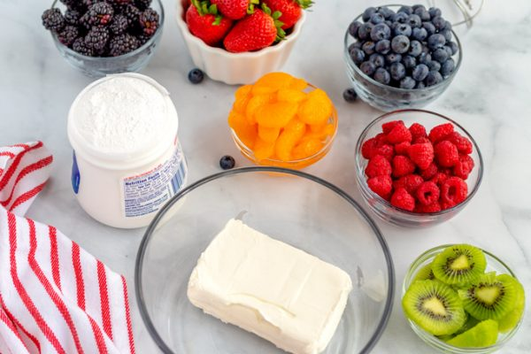 All of the ingredients needed to make fruit pizza.
