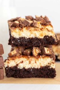 Two Cheesecake Brownies stacked on top of each other.