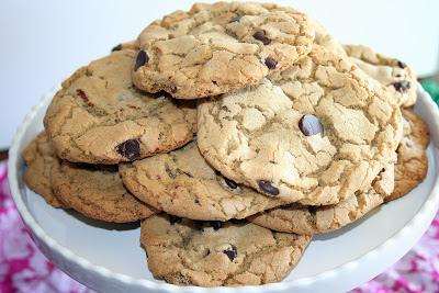 A stack of chocolate chip cookies on a plate