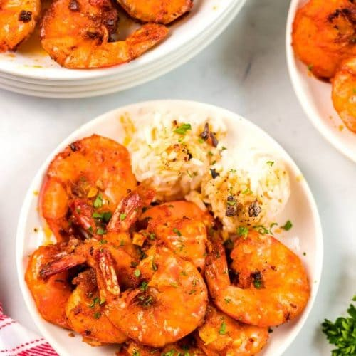 An overhead picture of garlic shrimp on a plate with rice.