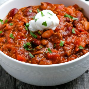 A close up picture of the finished easy crockpot chili in a white bowl.