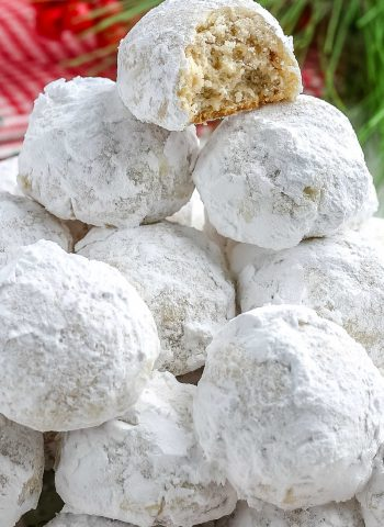 A close up picture of a pile of snowball cookies.