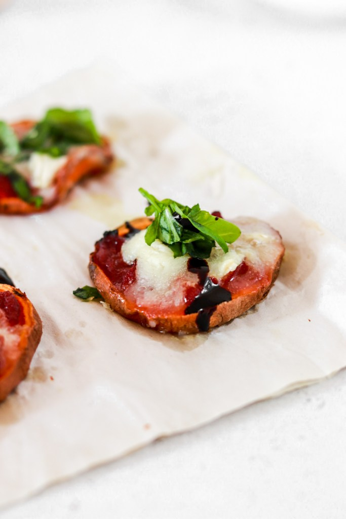 Sweet Potato Mini Pizza Bites (Gluten Free) with tomato sauce and goat cheese close up