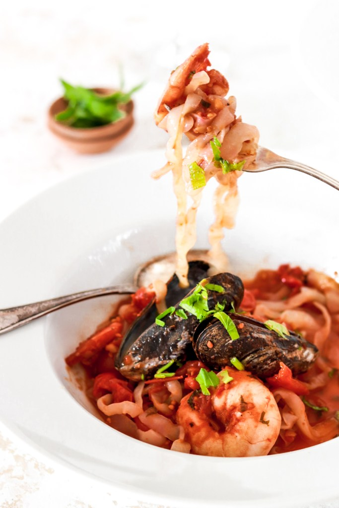 Seafood Pasta in a bowl on a fork