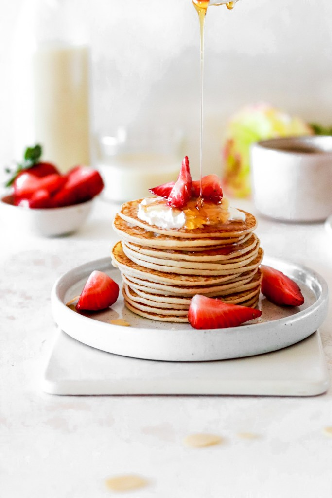 Almond Flour Pancakes (Gluten, Grain, Dairy & Sugar Free, Low Carb) On Plate Drizzling with Syrup