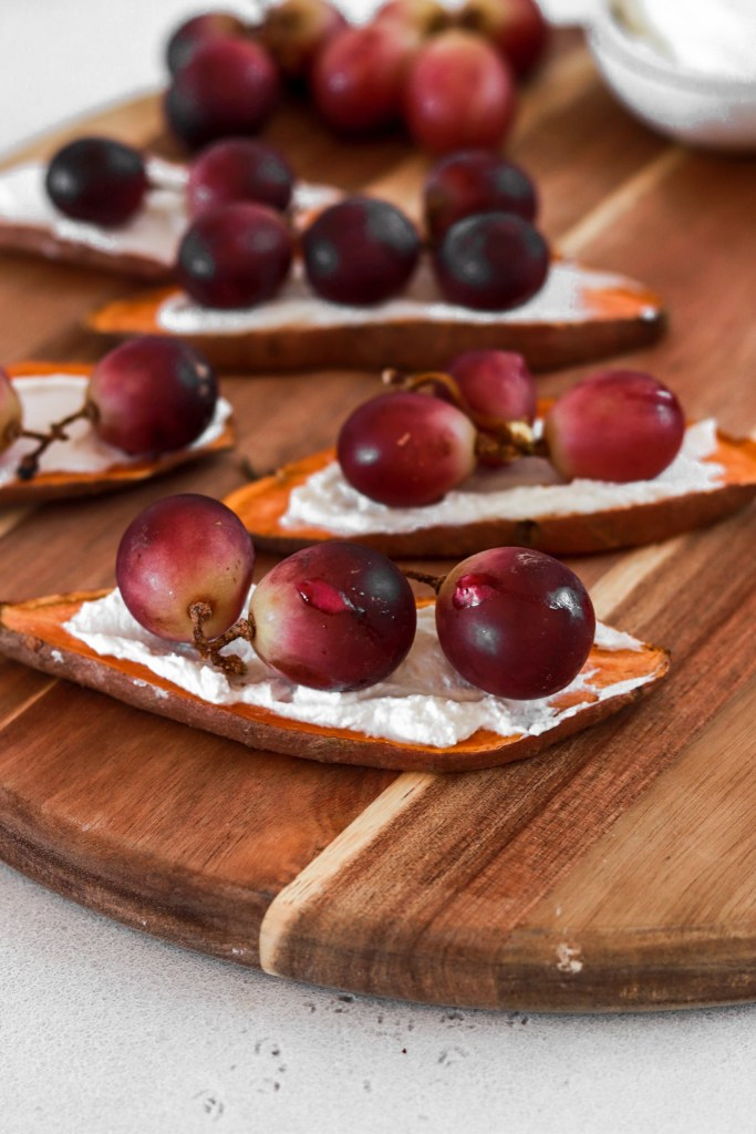 Sweet Potato Toast with Ricotta & Baked Grapes (Gluten & Grain Free) On A Cuttin Board from Close Up
