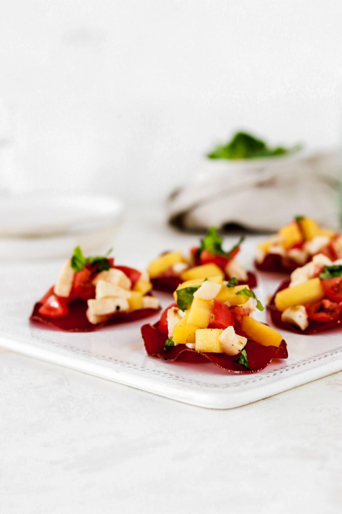 Bresaola Chips with Tomato, Mozzarella & Mango Salsa From Front