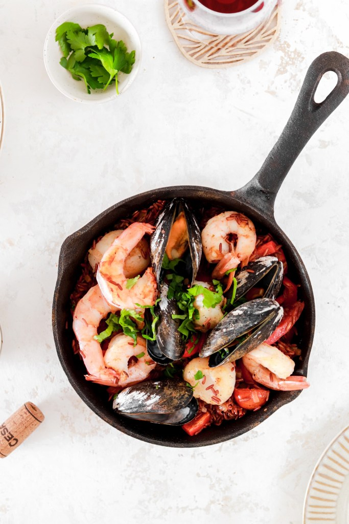 Red Rice Seafood Paella From Above In Skillet