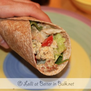 Pesto chicken salad wraps with bacon and spinach
