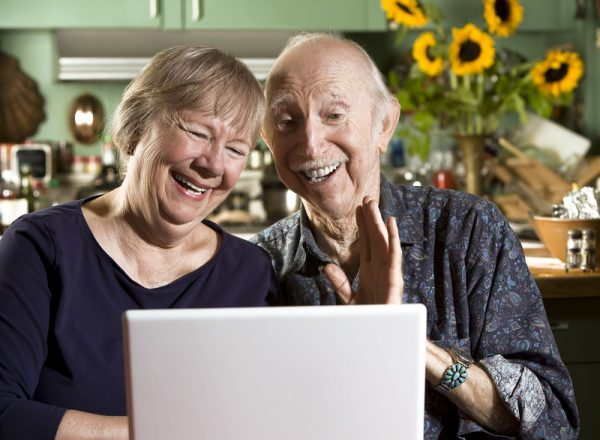 Grandparents using skype to talk with Grandchildren