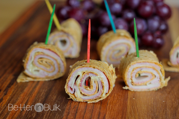 These Ham and Swiss Cheese Pinwheels make the perfect light appetizer or tasty lunch - and they're Weight Watchers friendly, so you can enjoy these cheesy snacks without the guilt!