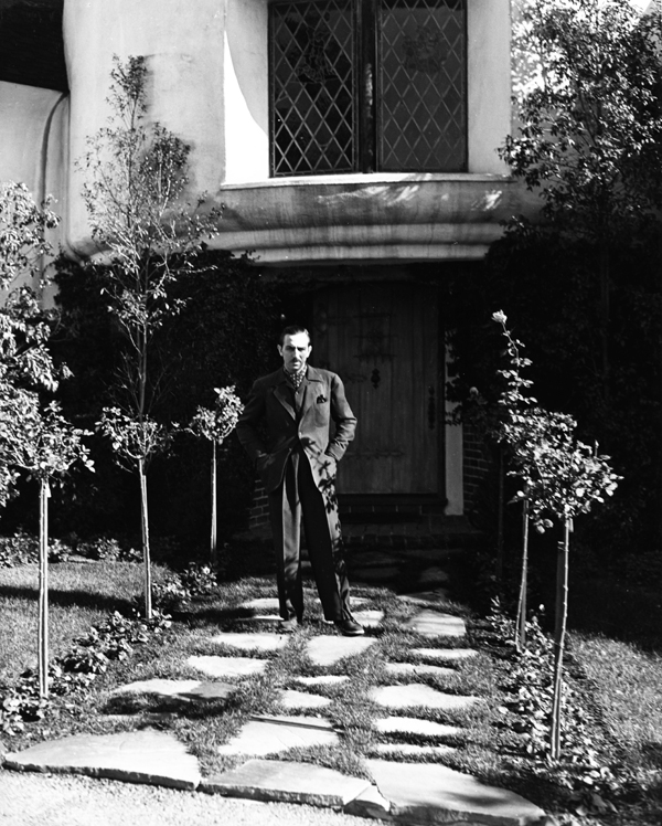 walt disney in front of house