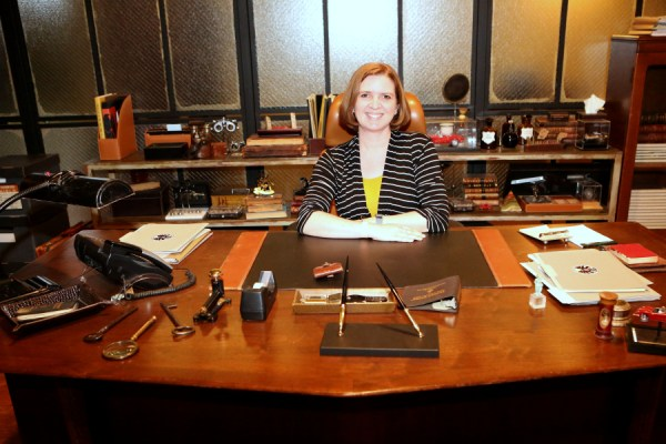 Agent Laura sitting at Coulson's desk on the set of Agents of S.H.I.E.L.D. | photo by ABC/Adam Taylor