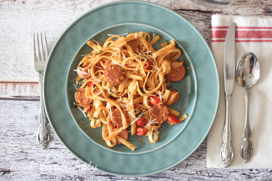 Do you ever have one of those nights where you have no time or desire or inspiration to cook dinner? This is a perfect quick meal for those nights - 15 Minute Creamy Tomato and Sausage Fettuccine
