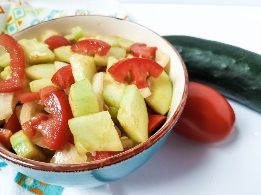 Cucumber tomato salad with vinaigrette dressing