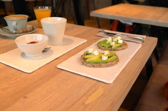 The breakfast option with avocado on toast, orange juice and coffee