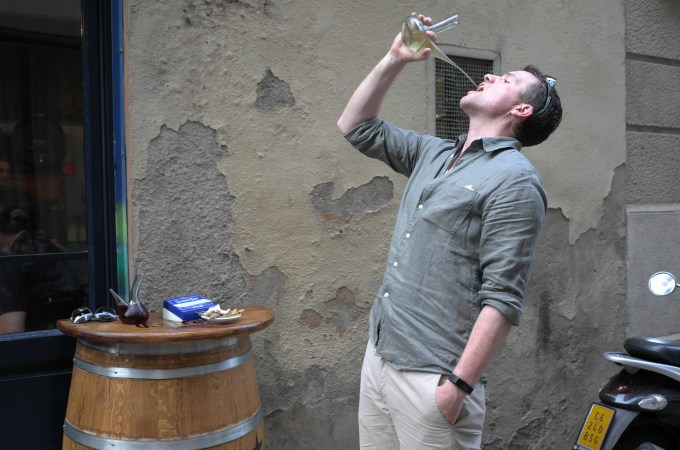 Drinking from a porron - this guy had it down to an art