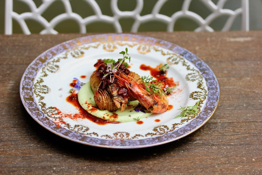 Shrimp and hasselback potatoes, one of the beautiful dishes we made on Bear on Bike Food Tour
