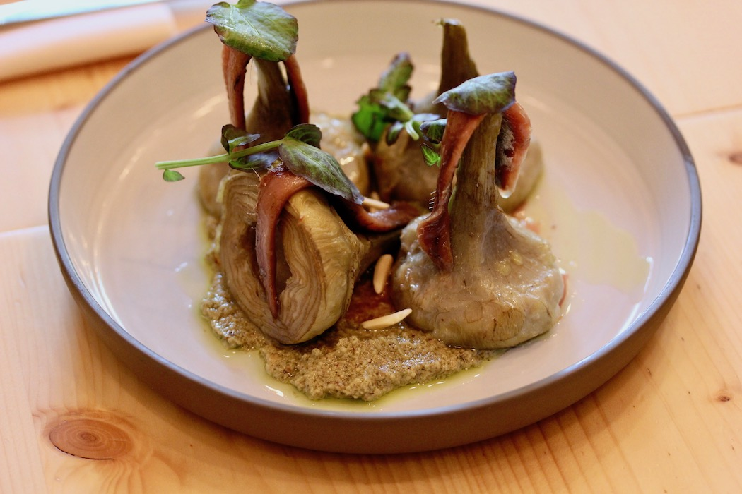 Artichokes with green romesco and anchovies at Embat Restaurant