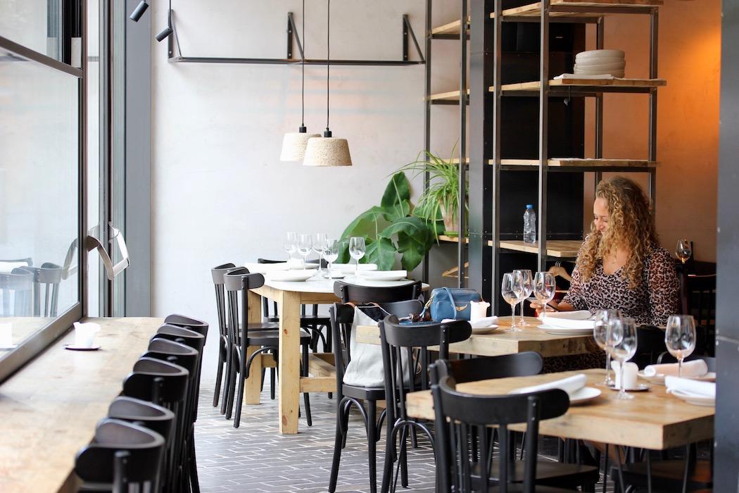 Woman eating at Fismuler Mediterranean Restaurant in El Born