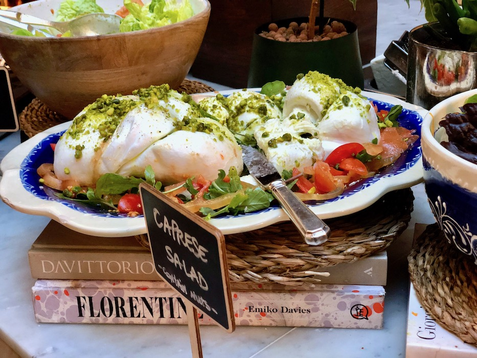 A giant dish of mozzarella with pistachios sprinkled on top