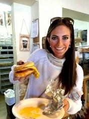 Me devouring the Breakfast Sandwich