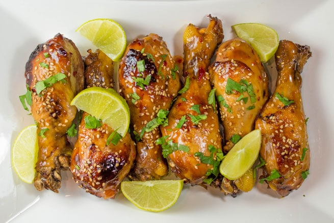 Sweet and spicy chili chicken drumsticks cook up melt-in-your-mouth tender in the crock pot.