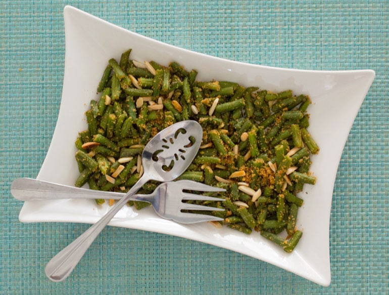 Easy green beans with garlic, breadcrumbs and almonds will be your family's new favorite veggie side dish!