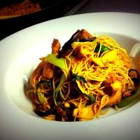 Asian flavors: egg noodles stir-fry with chicken and bok choy