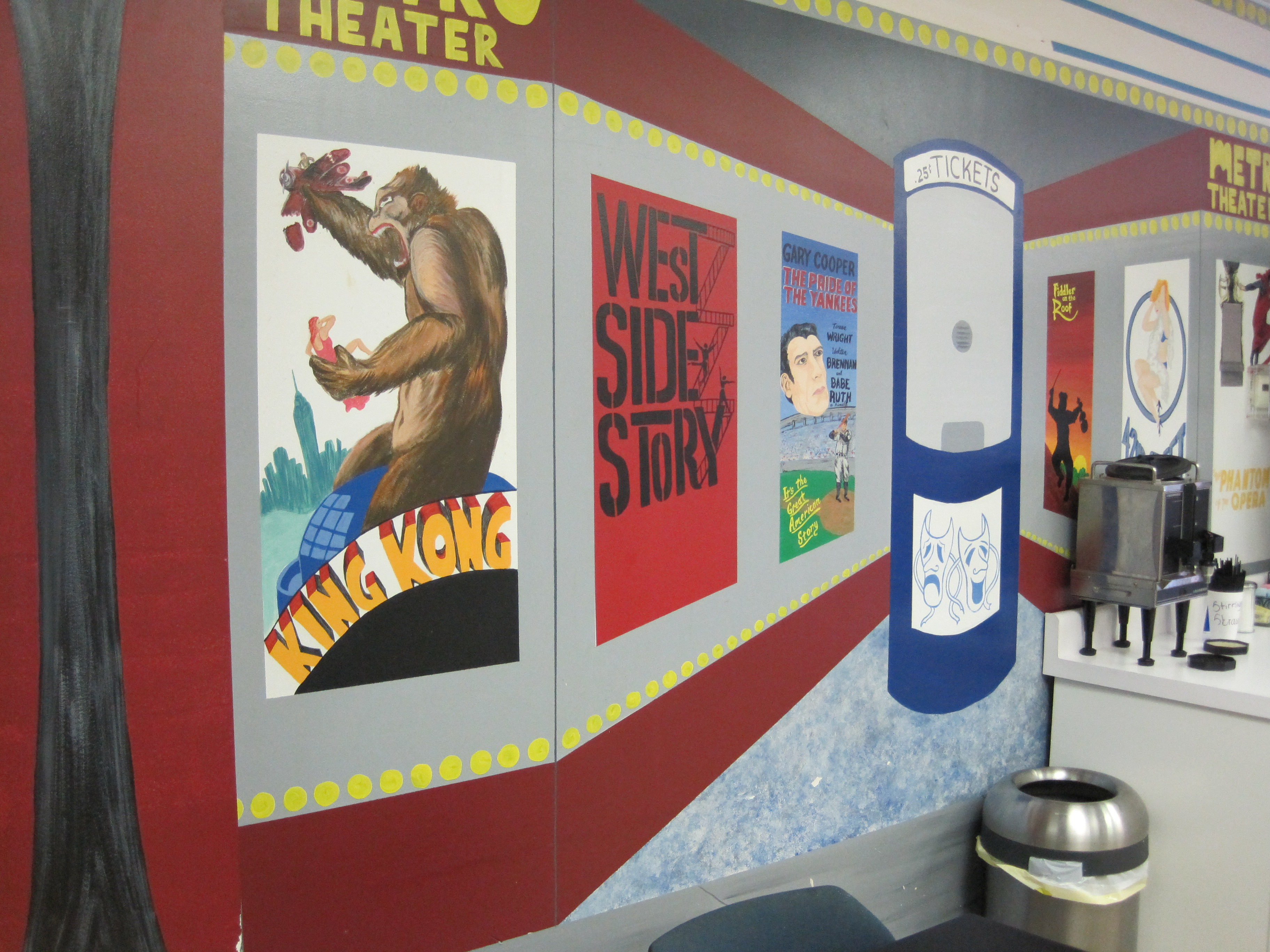 The walls of Jen's Deli are covered in a mural of movie images.