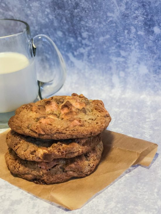 Stack of Bakes Smores Cookies with a Glass of Milk