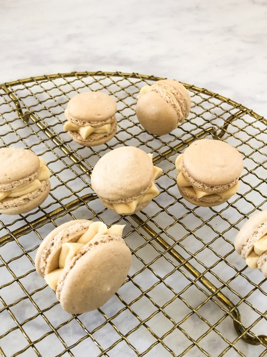 Salted Caramel Macarons on a Golden Rack - www.foodnerd4life.com
