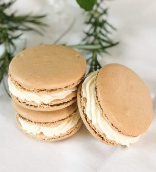 Stack of Elderflower Gin and Tonic Macaron with Rosemary in Background