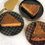 Spiced Pumpkin Pie with Speculoos Biscuit Crust Wedges on Plates and Gold Cake Slice