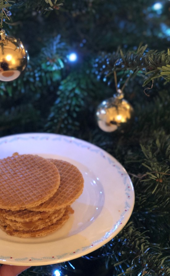 Plate of Stroopwafels infront of Christmas Tree- www.foodnerd4life.com